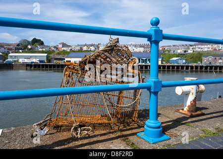 An old, rusty shopping trolley pulled out from Milford Haven Marina. - Stock Image