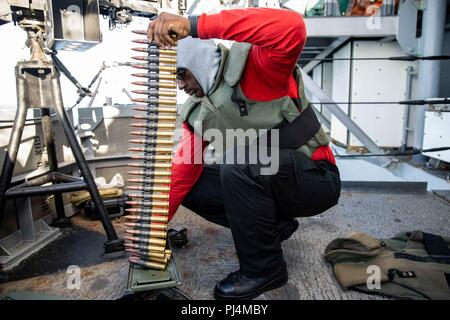 180829-N-KW492-0014 ATLANTIC OCEAN (Aug. 29, 2018) Aviation Ordnanceman 2nd Class Michael Brown prepares .50-caliber ammunition for a live-fire exercise aboard the Wasp-class amphibious assault ship USS Kearsarge (LHD 3) during the Carrier Strike Group FOUR (CSG 4) Amphibious Ready Group, Marine Expeditionary Unit exercise (ARGMEUEX). Kearsarge Amphibious Ready Group and 22nd Marine Expeditionary Unit are enhancing joint integration, lethality and collective capabilities of the Navy-Marine Corps team through joint planning and execution of challenging and realistic training scenarios. CSG 4 me - Stock Image