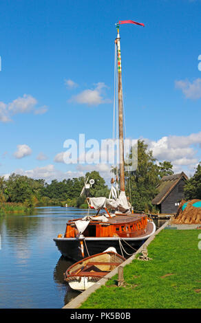 A view of the Norfolk Pleasure Wherry Hathor moored on the River Ant by How Hill, Ludham, Norfolk, England, United Kingdom, Europe. - Stock Image