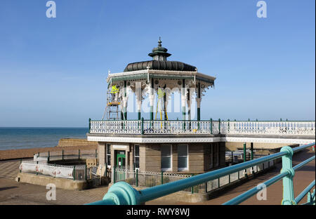 Brighton, UK. 8th Mar, 2019. The bandstand on Brighton seafront gets a lick of paint and Spring clean on a beautiful sunny morning . The bandstand was originally opened in 1884 and was restored to its original specifications in 2009 and is a popular venue for weddings now Credit: Simon Dack/Alamy Live News - Stock Image