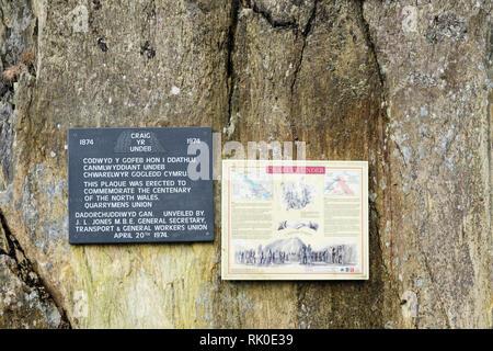 Information board & plaque commemorating centenary of North Wales Quarrymens union in 1974 on Union Rock or Craig yr Undeb. Llanberis Gwynedd Wales UK - Stock Image