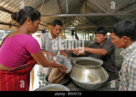 BANGLADESH Family buying fish fingedrlings for stocking the pond on the farm, at a hatchery in Haluaghat, Mymensingh region. They are members of the Garo tribal minority photo by Sean Sprague - Stock Image