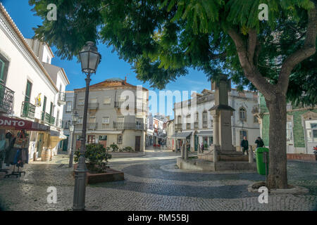 A Large Tree Shades A Square In The Old Town Of Lagos Portugal - Stock Image