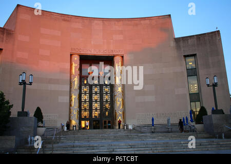 NEW YORK, NY - JUNE 14: Brooklyn Public Library bathed in red sundown light on summer evening, Brooklyn on JUNE 14th, 2017 in New York, USA. (Photo by - Stock Image