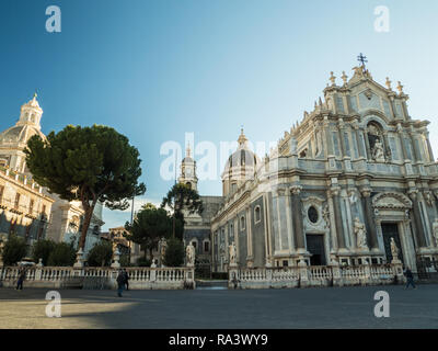 PIazza del Duomo with the Cathedral of Saint Agatha (Sant'Agata) right and the Church of the Badia di Sant'Agata left, Catania, Sicily, Italy. - Stock Image