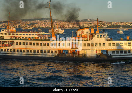 Ferry boats sail on the water between the Golden Horn and the Bosphorus in Istanbul. - Stock Image