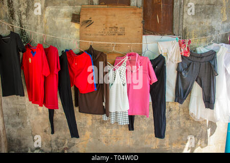 Clothes washing hanging out to dry in a city street setting. - Stock Image