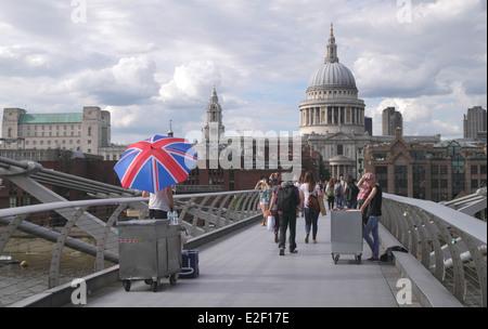 People walking on the Millennium Bridge London June 2014 - Stock Image