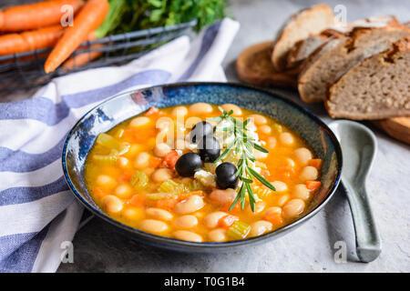 Fasolatha – delicious Greek white bean soup sprinkled with feta cheese - Stock Image