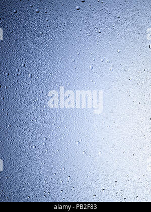A graphic vertical framed shot of some dew, droplets or condensation. - Stock Image