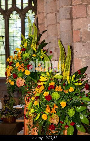 UK, England, Devon, Crediton, Parish Church Flower Festival, arrangement against pillar to Choir - Stock Image