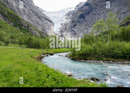 View along river to Briksdalsbreen or Briksdal glacier arm of Jostedalsbreen glacier in Briksdalen in Jostedalsbreen - Stock Image