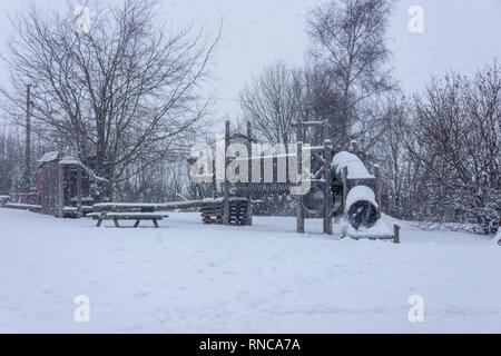 Children's playground covered with snow in winter - Stock Image