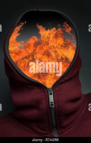Man in hoody with a look of fear and surprise on his face. - Stock Image