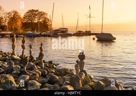 Zurich lakeside balanced stones sunset - Stock Image
