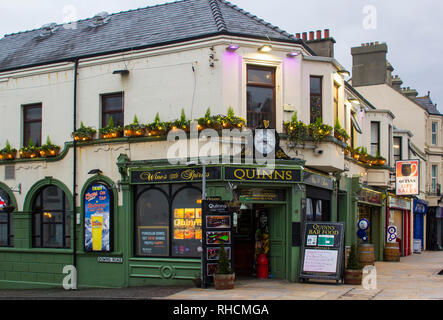 14 December 2018 Quinn's Traditional Irish Pub in Newcastle County Down in late afternoon light in midwinter - Stock Image