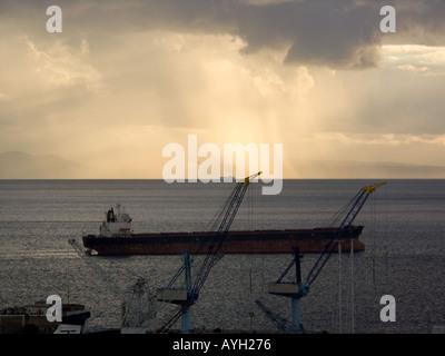 Sunset over the Bay of Gibraltar, sunset sunsets dusk ship ships shipping tanker tankers Bay of Gibraltar Gibraltarian Europe, - Stock Image