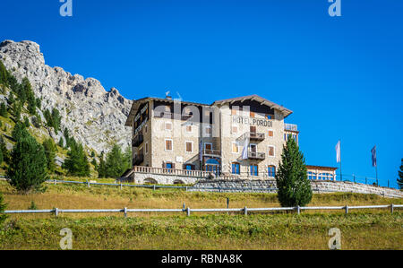 Typical alpine hotel located on Pordoi mountain pass where tourists can spend vacation, Dolomites Mountains, northern Italy, Europe - Stock Image