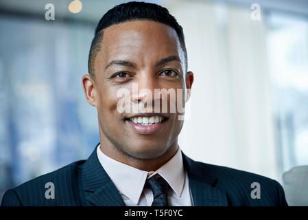 Portrait of businessman in office - Stock Image