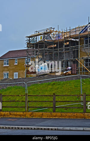 Wimpey Taylor building site at Coity near Bridgend, South Wales. New homes under construction at this popular site. - Stock Image