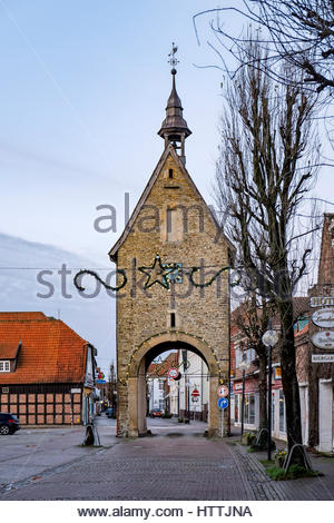 Christmas decorations are hung by tower and entry arch, remnants of old town perimeter wall of Fürstenau, Germany. - Stock Image