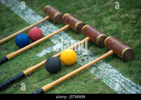 Croquet set laid out ready to play, croquet mallets and balls.Jayne Russell / Alamy Stock Photo - Stock Image