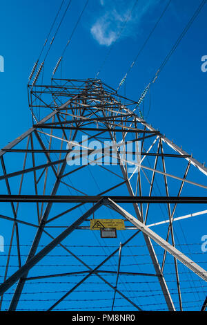 A transmission tower or power tower is a tall structure, usually a steel lattice tower, used to support an overhead power line. - Stock Image