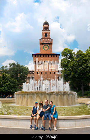 Vertical view of tourists outside the Castello Sforzesco and Torre del Filarete in Milan, Italy. - Stock Image
