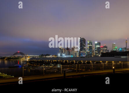 cloudy early morning at sydney harbour and city - Stock Image