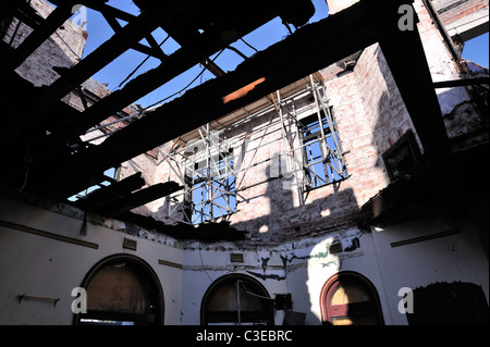 Burnt out interior of building destroyed by arsonist - Stock Image