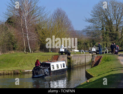 Narrowboat entering a lock near Tring Reservoirs, on The Grand Union Canal, Aston Clinton, Buckinghamshire / Hertfordshire Border, England, UK - Stock Image