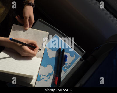 hand over diary book writing blog words travel checklist train table with map - Stock Image