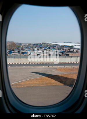 View of a slum area next to Chhatrapati Shivaji airport in Mumbai viewed from an airline window India - Stock Image