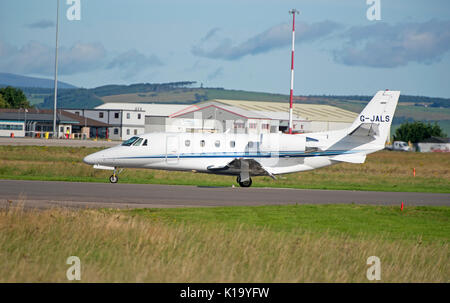 Thin engine Air Charter Cessna 560 arriving at Inverness Dalcross airport - Stock Image