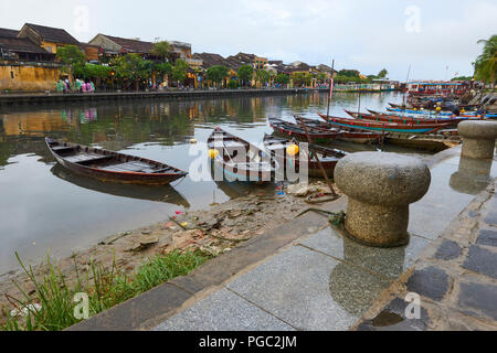 Rowing boats docked in the main canal in the UNESCO World Heritage Site town of Hoi An, in Central Vietnam. - Stock Image
