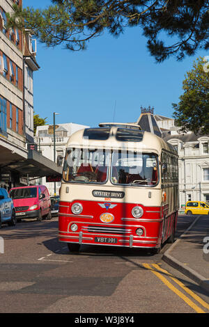 Mystery Drive vintage coach parked in road at Bournemouth, Dorset UK in July - Stock Image