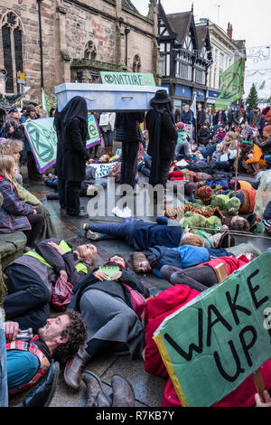 Hereford, UK. Members of Extinction Rebellion (climate change activists) stage a mass die-in or extinction event in the city centre on 1/12/2018 - Stock Image