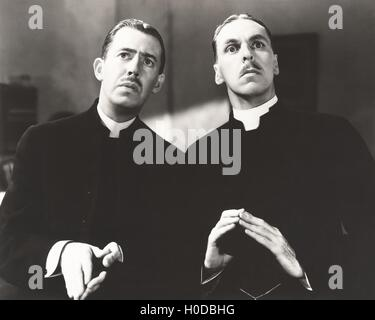Two solemn priests - Stock Image