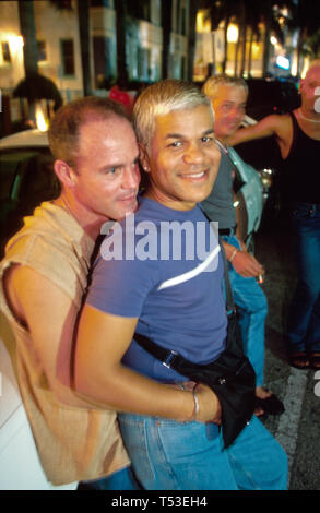 Miami Beach Florida South Beach Ocean Drive males hugging in public alternative lifestyles nightlife - Stock Image