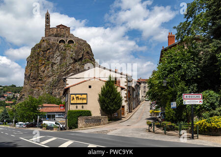The Chapel of St Michel-dAiguilhe in the city of Le Puy-en-Velay in the Auvergne-Rhone-Alpes region of France. Built in 969 on a volcanic plug 85m (27 - Stock Image