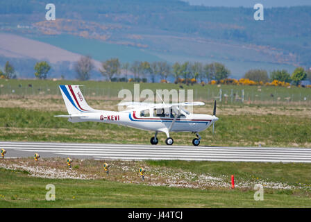 Jabiru400 G-KEVI Taxiing onto 05 Runway at Inverness Airport. - Stock Image