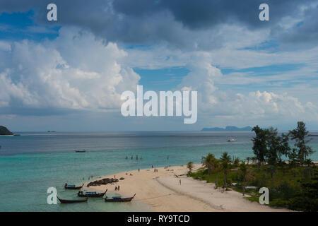 Longtail boats on Ko Lipe Sunrise beach, Thailand - Stock Image