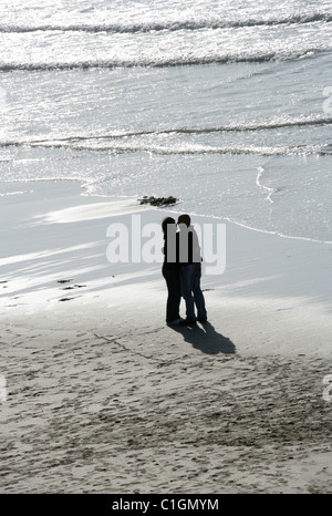Romantic Couple on a Beach, Cornwall. - Stock Image