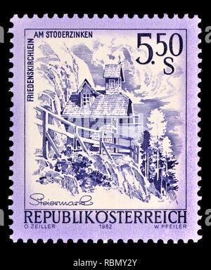 Austrian definitive postage stamp (1982) : Friedenskirchen am Stoderzinken - Stock Image
