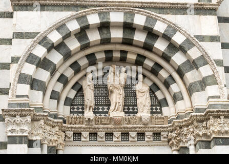 Detailed view of religious statuary above the door of the Baptistery of San Giovanni, Pistoia, Tuscany, Italy, Europe - Stock Image
