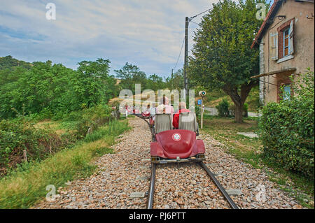 Tourists riding on the velorail between Lamastre and Boucieu-le-Roi in the Ardeche region, France. - Stock Image
