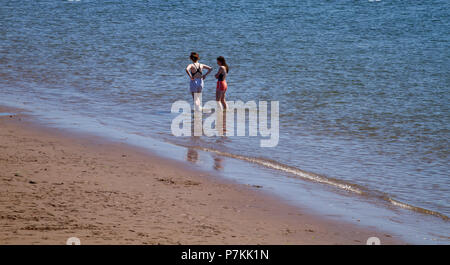 Dundee, Tayside, Scotland, UK. 7th July, 2018. UK weather: The heatwave continues with temperatures reaching 24º Celsius. Two young girls in the water enjoying the hot sunny weather at Broughty Ferry beach in Dundee,UK. Credits: Dundee Photographics / Alamy Live News - Stock Image