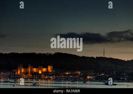 Conway castle at dusk on the North Wales coast - Stock Image