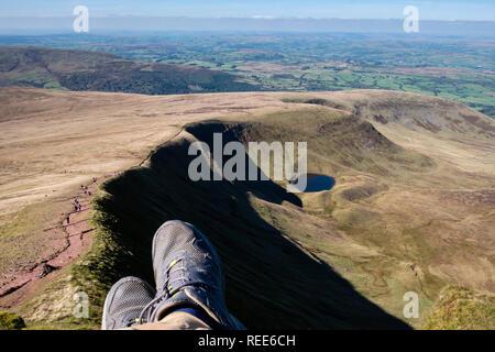 Walker on Pen y Fan & Corn Du mountains Brecon Beacons Powys Wales - Stock Image