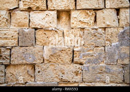 wall of old limestone blocks, exterior. - Stock Image